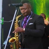 Music director and consultant, offering cool and easy approach professional saxophone lessons in Abuja.